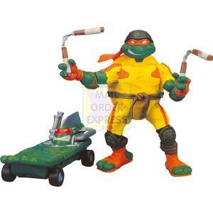 Игрушки и фигурки TMNT общая тема  - микеланджело на скейте.jpg