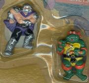 Изображения TMNT, их символика и т.п. на различных предметах - Микеланджело и Шреддер - магниты.jpg